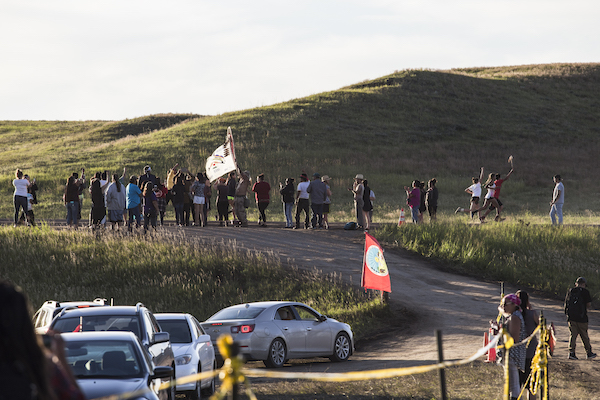 Youth runners from the Cheyenne River Sioux Reservation—the Standing Rock Reservation's closest neighbor to the south—ran to the prayer campsite in Cannon Ball. They left at 7a.m. on Saturday August 20, traveling about 100 miles on foot, and arrived at the construction site near the camp in the early evening. Thousands joined in welcoming the runners, who are in support of the #NoDAPL campaign. (Photo: Thosh Collins).