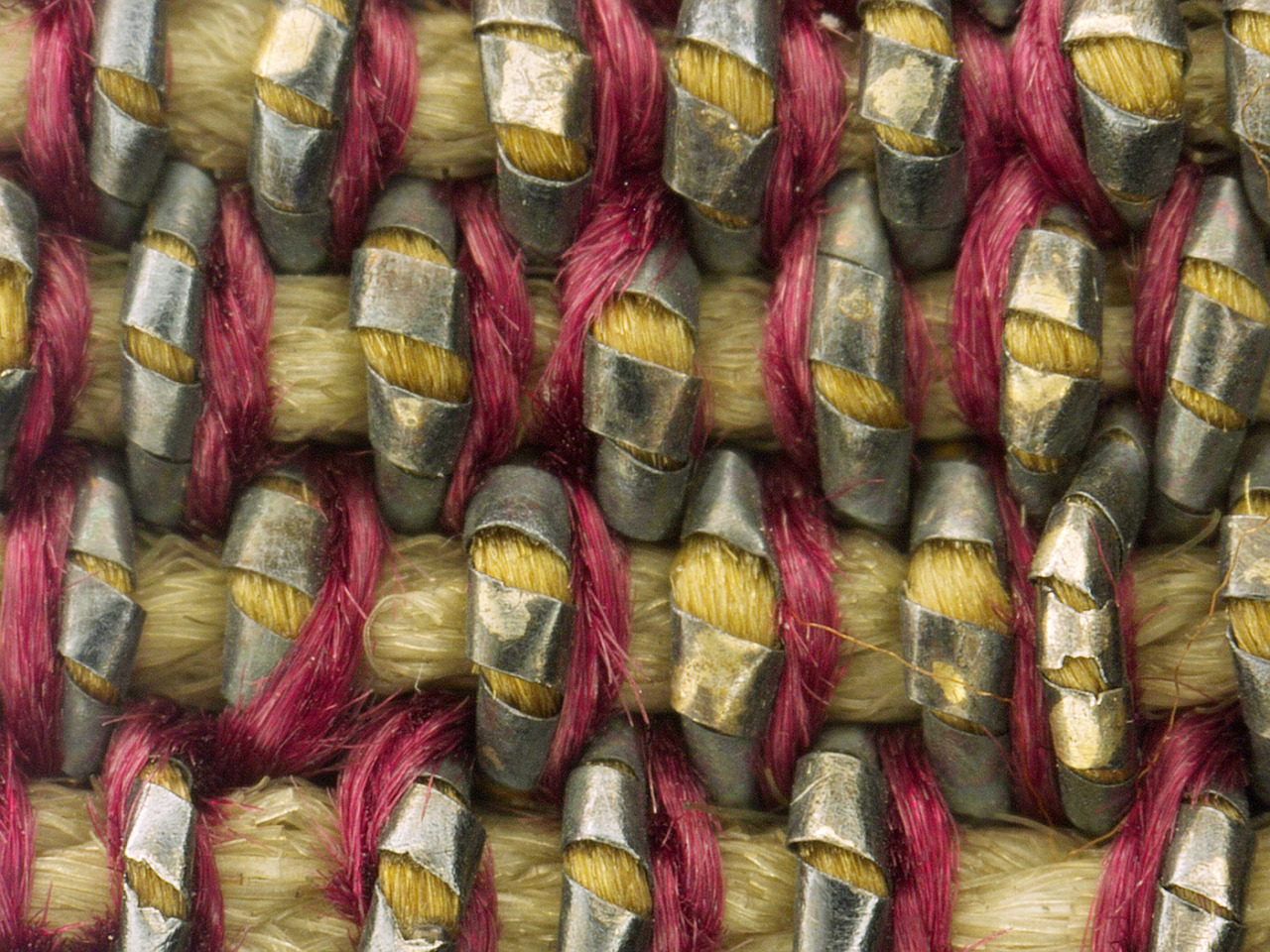 This photomicrograph shows the warp and weft threads used to create a background detail in the Triumph of Bacchus tapestry.