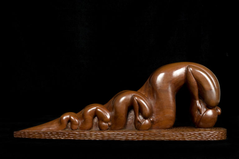 "Willard Stone, ""War Widows"" (nd), wild cherry wood, 7 1/2 x 20 1/2 x 4 1/2 inches (courtesy Gilcrease Museum)."