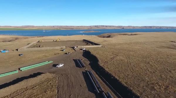 Courtesy Dr0ne2bewild Shiyé Bidziil/Vimeo. Energy Transfer Partners has gone so far as to build its drilling pad for tunneling under the Missouri River at Lake Oahe, even though it still awaits the necessary easements.