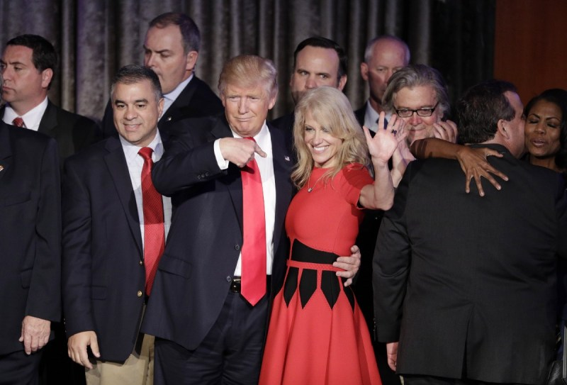 Donald Trump and campaign manager Kellyanne Conway celebrate during an election night rally. CREDIT: AP Photo/John Locher.