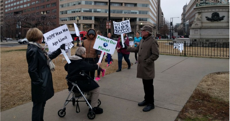 Three of the half-dozen octogenarian protesters who set up shop near the senior citizens' residence where they live in downtown Washington, D.C., during Saturday's Women's March. CREDIT: Alan Pyke/ThinkProgress.