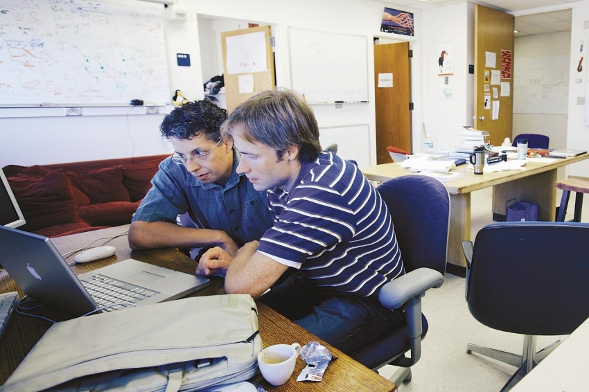 Carl T. Bergstrom (left) and Jevin West, of the U. of Washington, want to teach students how to survive the avalanche of false or misleading data shaken loose by shifts in media, technology, and politics.