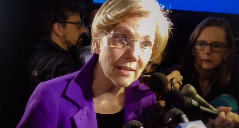 Elizabeth Warren speaks to reporters at MLK Breakfast in Boston (Gintautas Dumcius/Twitter).