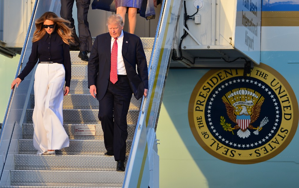 President Trump and his wife Melania Trump arrive on Air Force One at the Palm Beach International Airport on February 10. CREDIT: MPI10 / MediaPunch/IPX.