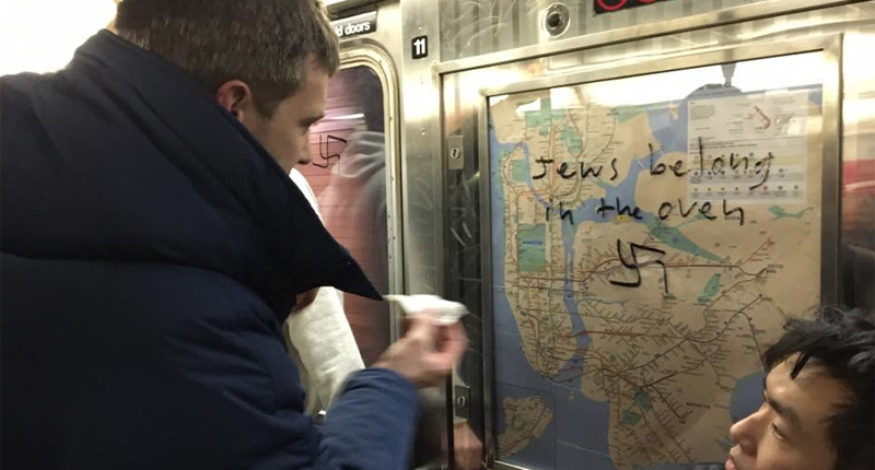 Rider cleans up Nazi graffiti -- Twitter.