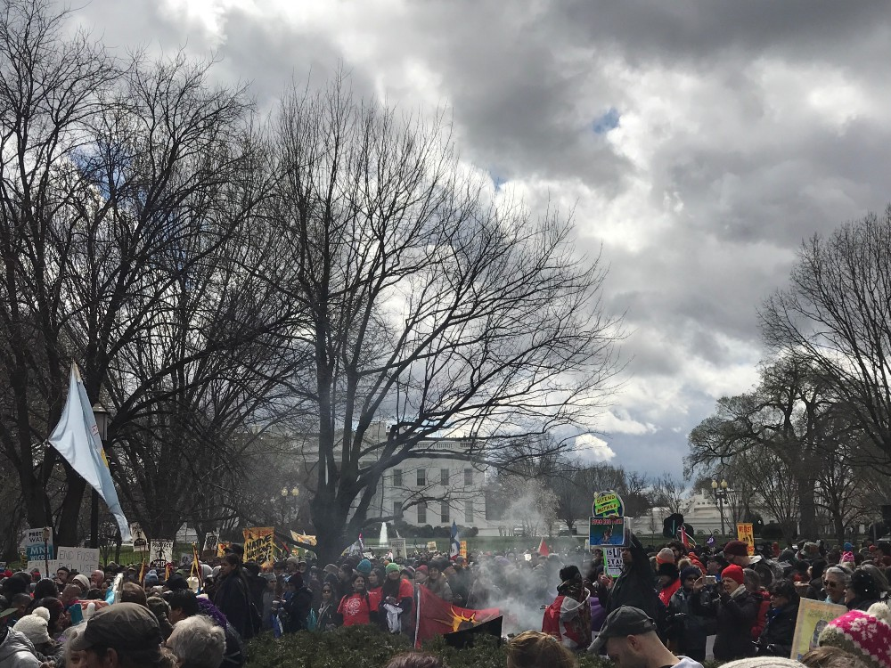 Protesters gather outside of the White House. CREDIT: Natasha Geiling.
