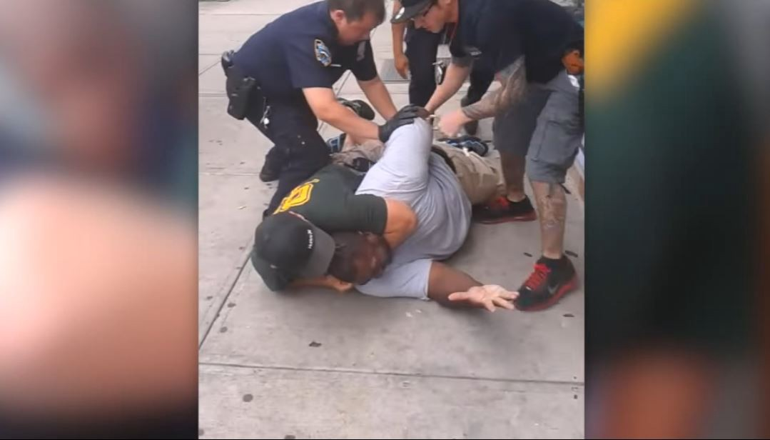 NYPD Officer Daniel Pantaleo holds Eric Garner in a fatal chokehold. CREDIT: YouTube/New York Daily News.