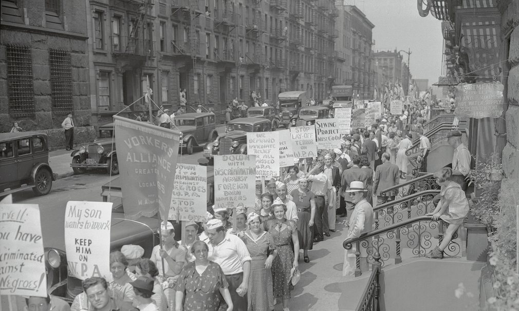 A large crowd marches through New York City in 1937 to demand workers' rights. Photograph: Bettmann Archive.