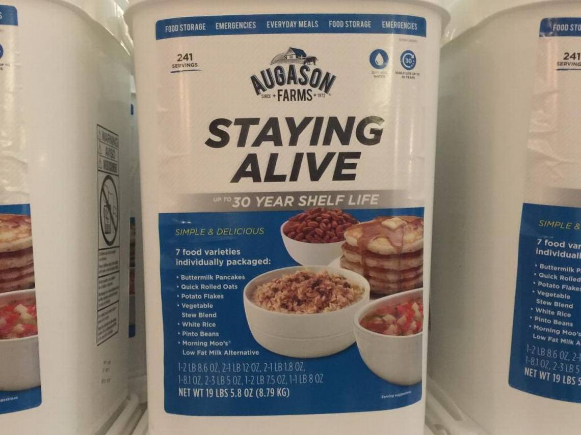 """Staying Alive"" is among the buckets of emergency food available from ""The Jim Bakker Show"" for a donation. Inside: 241 servings of buttermilk pancakes, potato flakes, vegetable stew blend, Morning Moo's low fat milk alternative and more. Tim Funk, Charlotte Observer."