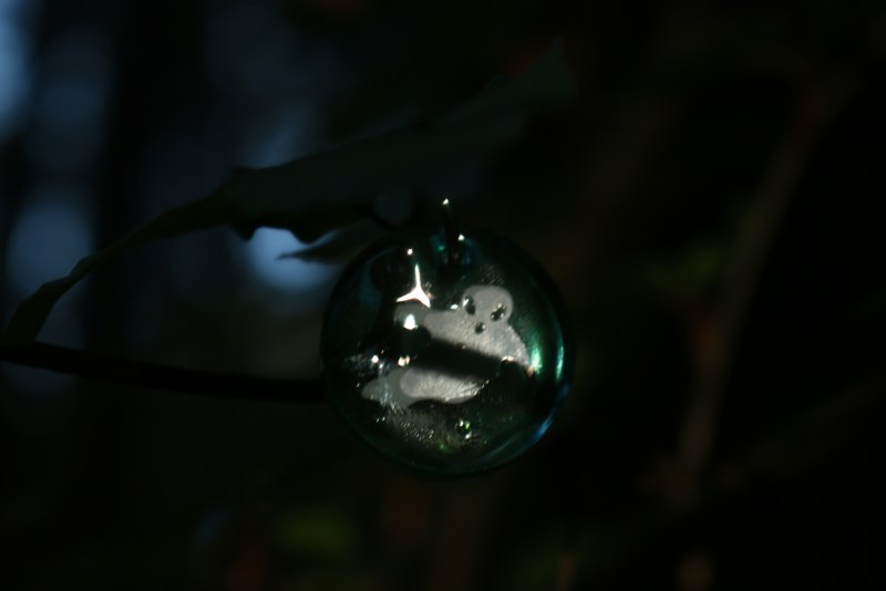 Pendant with ghost