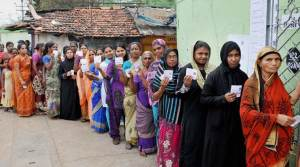 Women standing in queue to cast their vote during assembly elections in Coimbatore on Monday. PTI photo