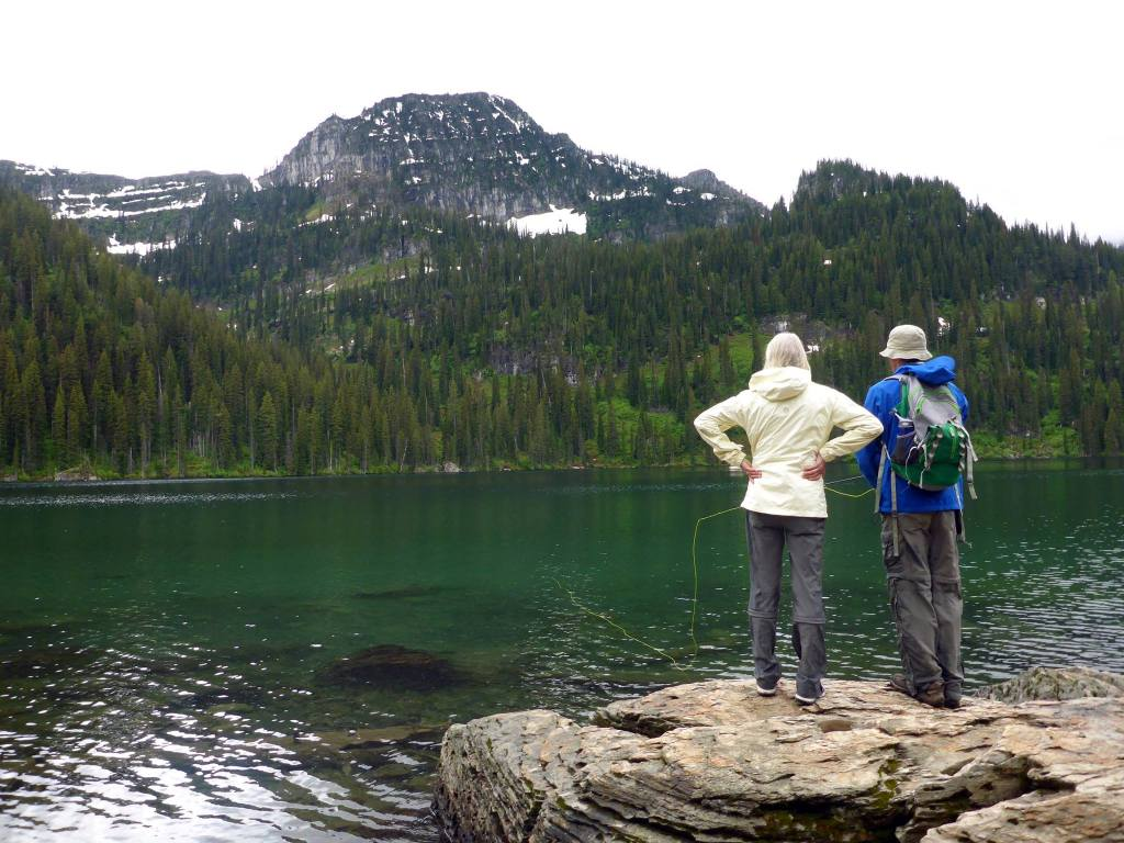 Teaching my mom a roll cast, Lower Cold Lake, Montana. Photo by Aeravi.