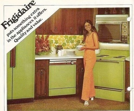 1970s Frigidaire appliances ad feat. photo of woman cooking while dressed in matching pink and white checkered top and pants.