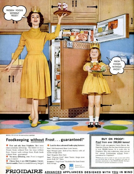 1970s Frigidaire Frost Free Refrigerator ad: mother and daughter, identically dressed in golden-yellow dresses and wearing paper crowns (?!), present platters of food next to the open refrigerator.