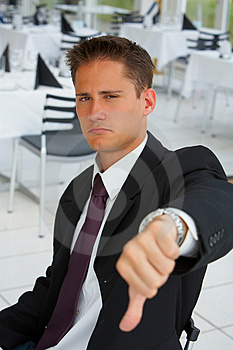 Stock Images - Businessman turning down an offer