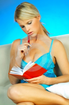 Stock Photo - Blonde woman with datebook.