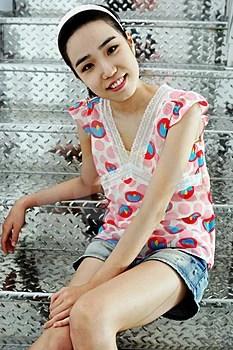 Stock Photo - Korean woman on silver stairs
