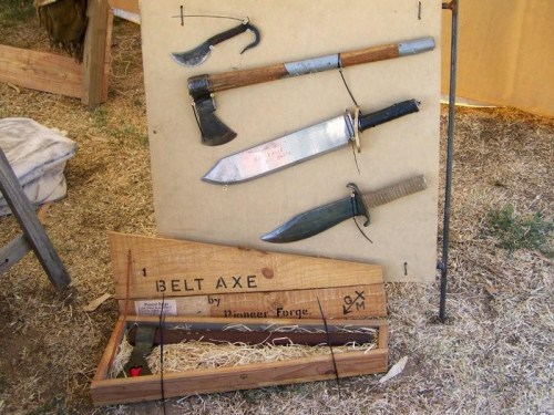 A cased belt axe and other useful alternate farming tools.