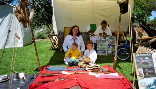 Lisa with Nicholas and Nathaniel at the Club's display at MMFAT while at the right rear Bob examines a butcher's knife.
