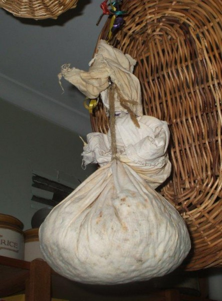 Christmas pudding (1774 style) hangs in Irene's pantry