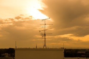 Tower of TV antennas at dawn