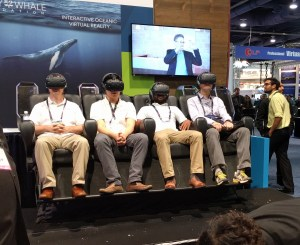 Four men in virtual reality chairs