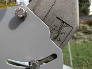 Close-up of the side of a dish motor showing angle marks