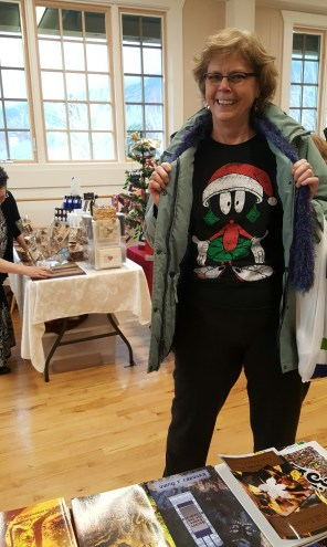 Attendee sporting her Marvin the Martian Santa shirt
