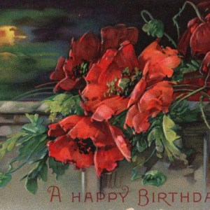 Vintage birthday card with red flowers and gold in public domain.