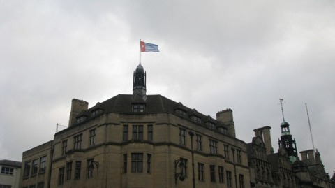 The Morning Star flag flies above Oxford Town Hall.