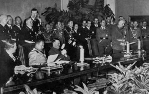 Signing of Tripartite Pact by Germany, Japan, and Italy on 27 September 1940 in Berlin. Seated from left to right are the Japanese ambassador to Germany Sabur? Kurusu, Italian Minister of Foreign Affairs Galeazzo Ciano, and Adolf Hitler. Via Wikipedia.