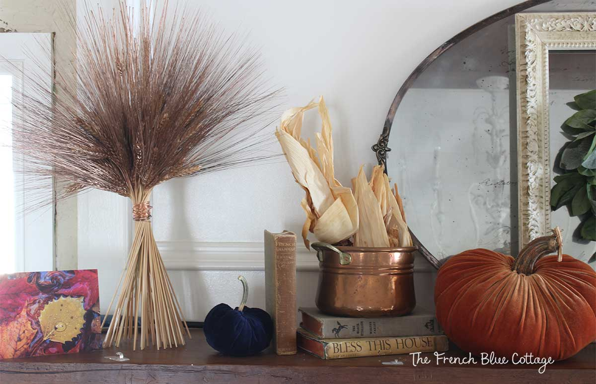 Copper wheat bundle wrapped with copper wire on a fall mantel.