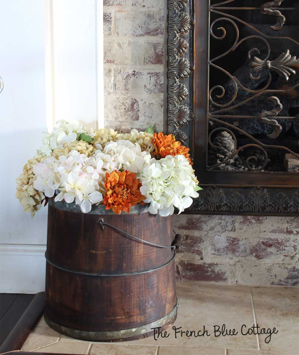 Wood bucket with fall flowers.