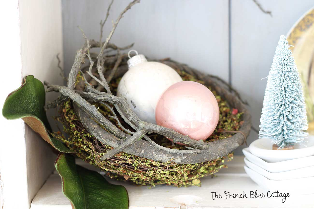 Vintage Christmas ornaments in a nest.