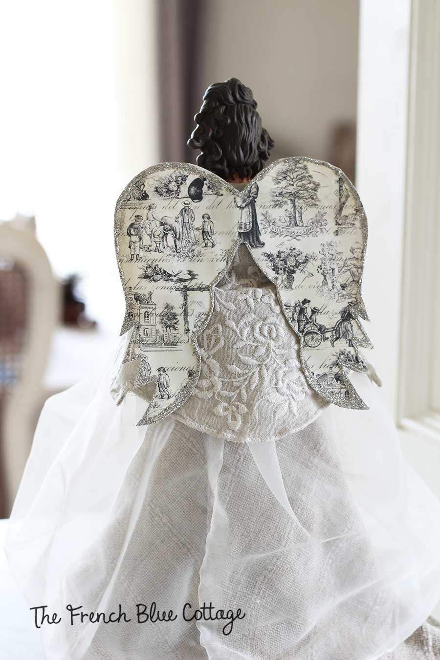 Christmas tree angel with toile wings.
