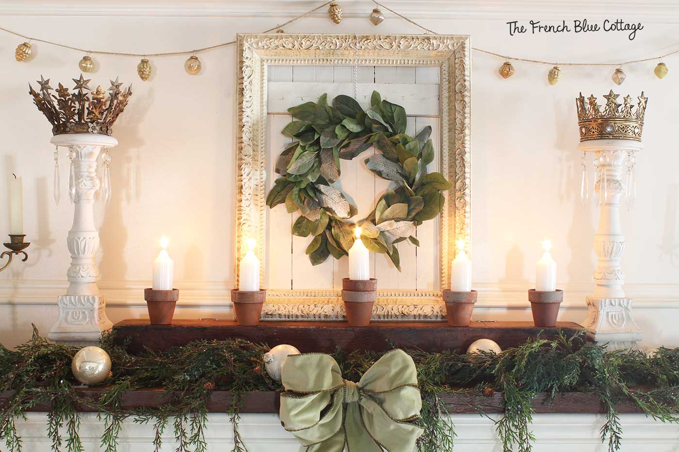 French country mantel with white candles.