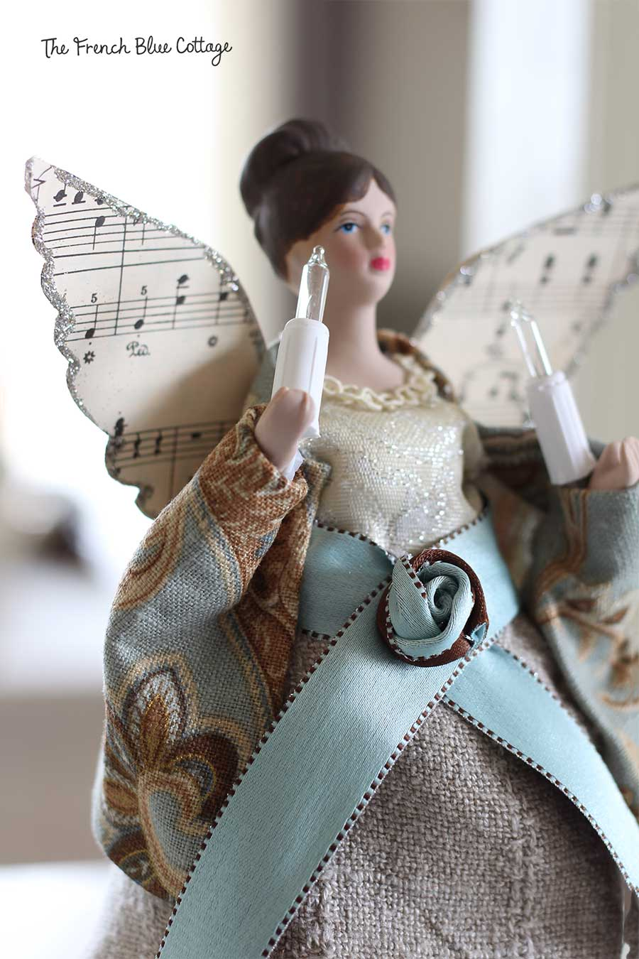 Tree angel makeover with sheet music glitter wings.