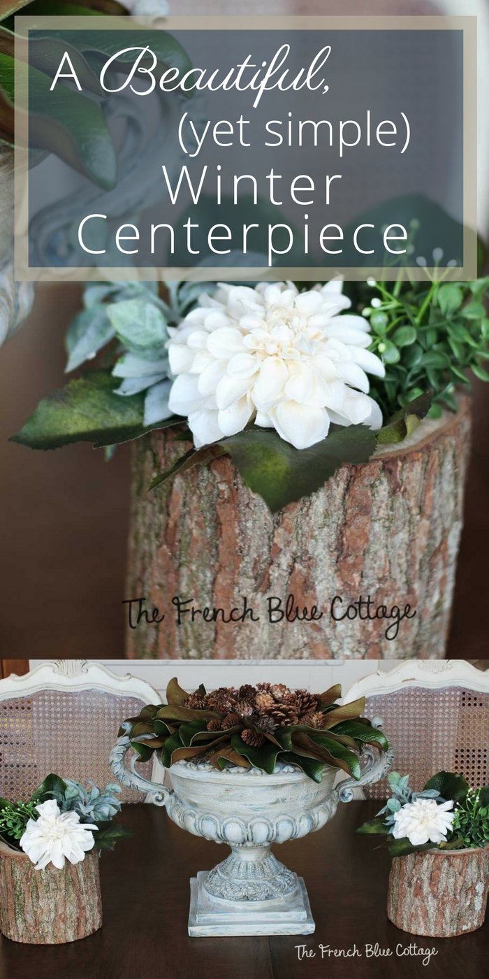 a simple winter tablescape centerpiece with magnolia and pinecones