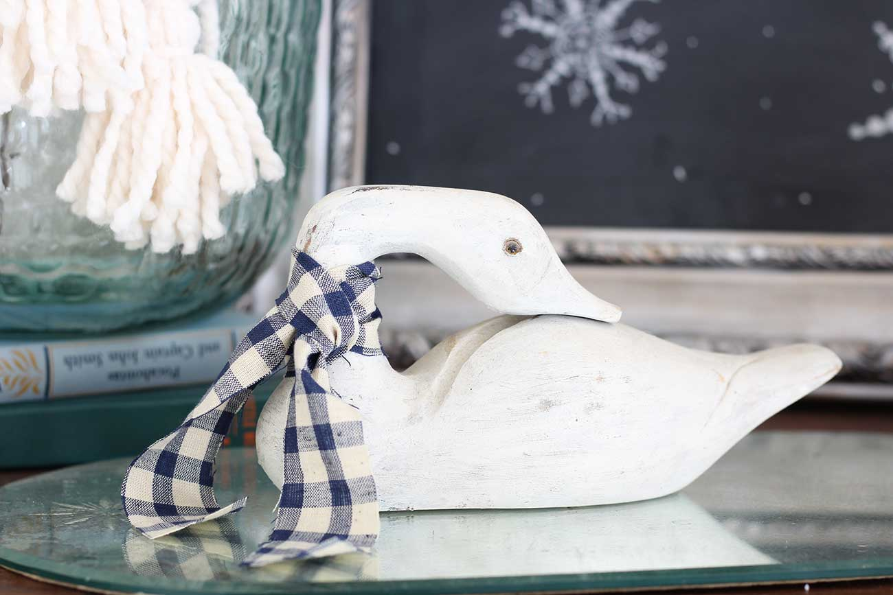 Goose with gingham scarf or bow.