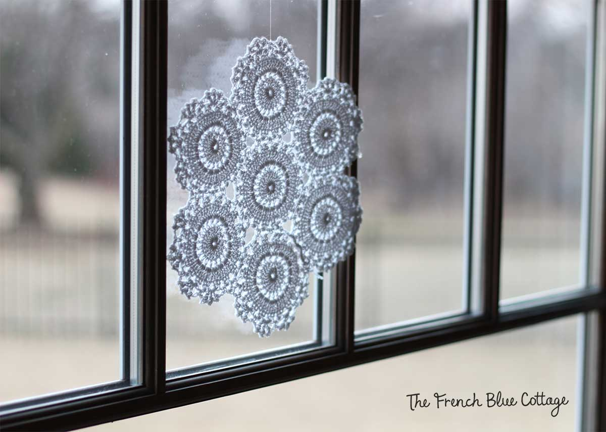 Large crocheted snowflake.