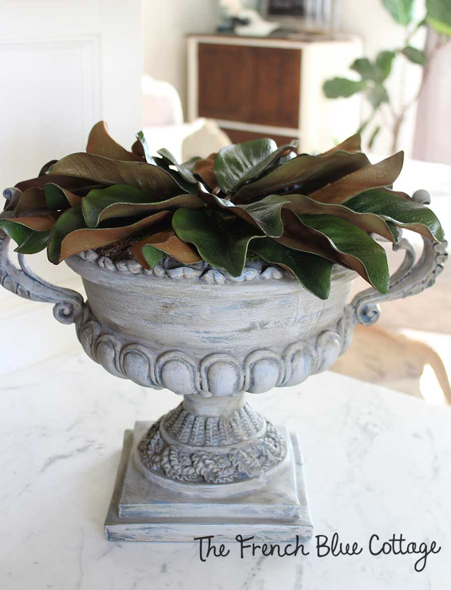 Magnolia leaves in an urn for winter.