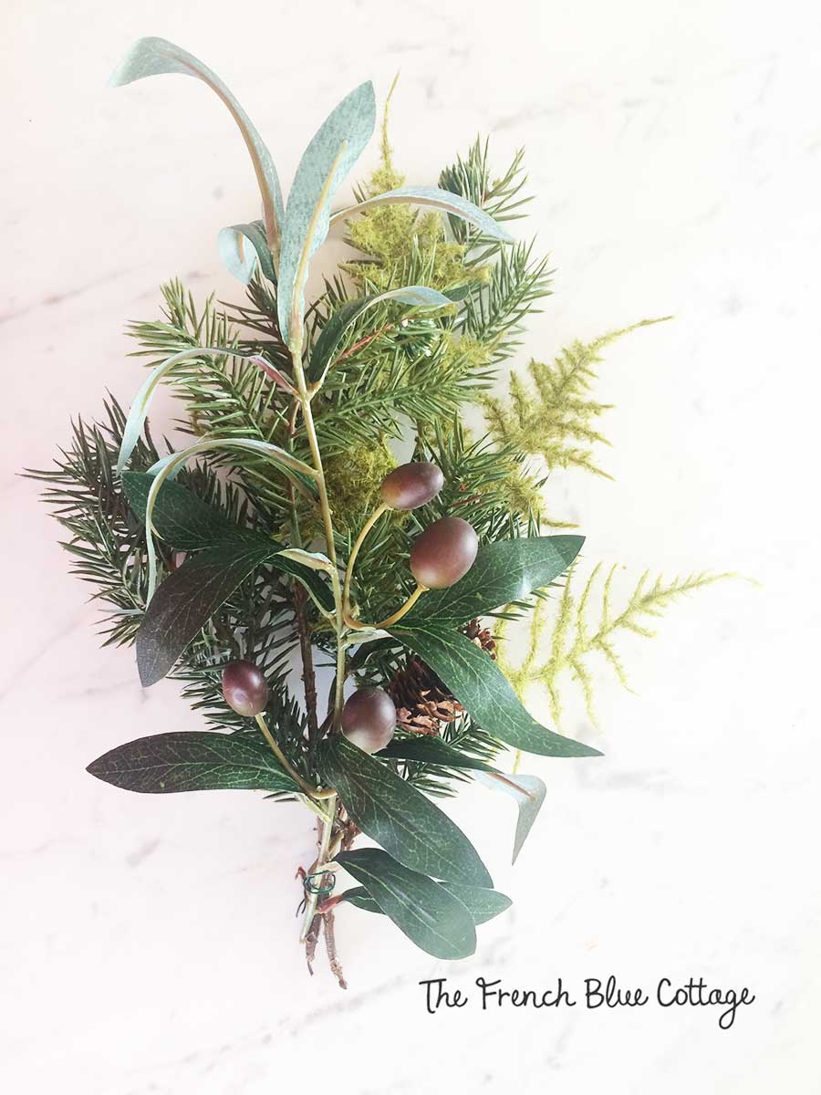 Mixed greenery sections for winter wreath.