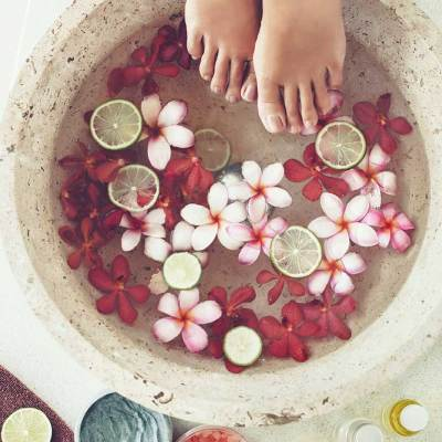 spa feet pedicure bowl with flowers