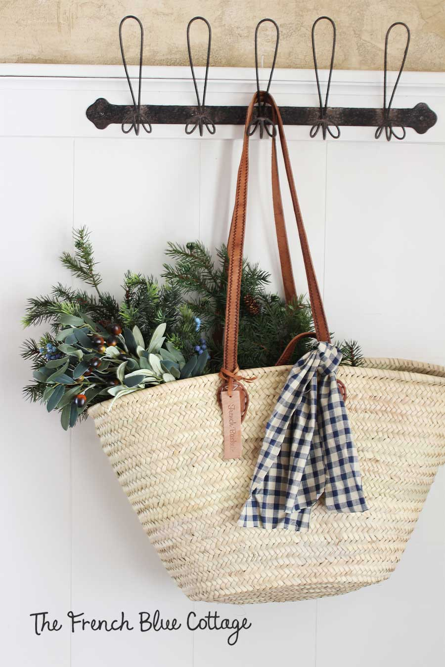 Hanging basket in the entry with evergreens and gingham.