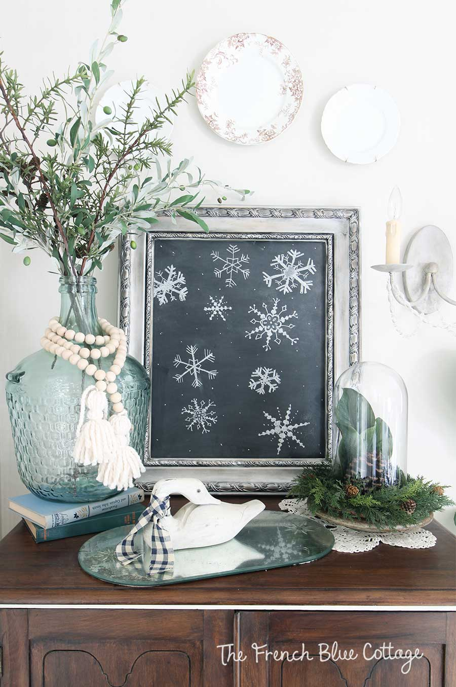 Winter vignette with wood beads and chalkboard snowflakes.