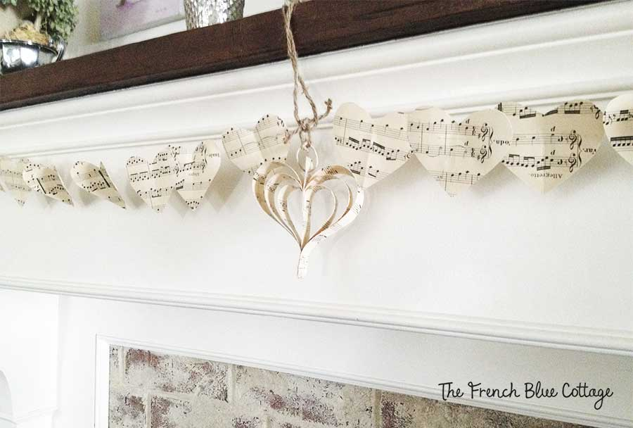 heart sheet music garland on mantel