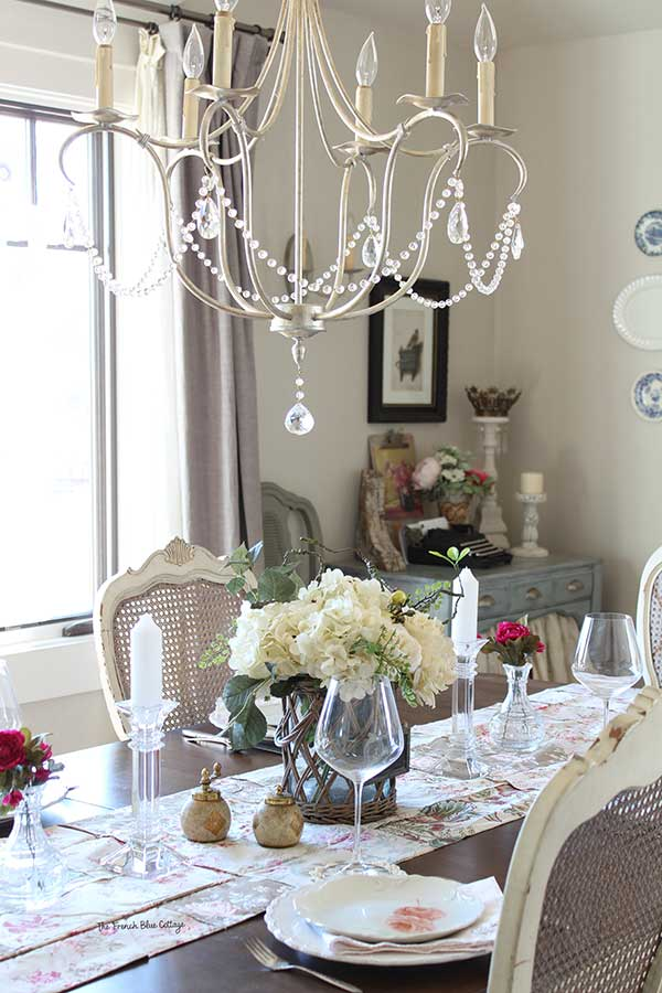 Shabby chic dining with crystal.