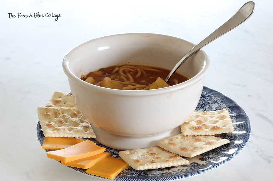 Grandmama's soup or stew with crackers and cheese.