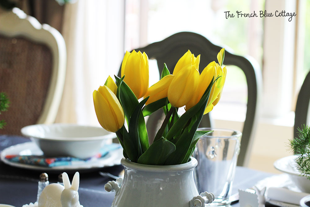Bright yellow tulips are the centerpiece on the Easter table.